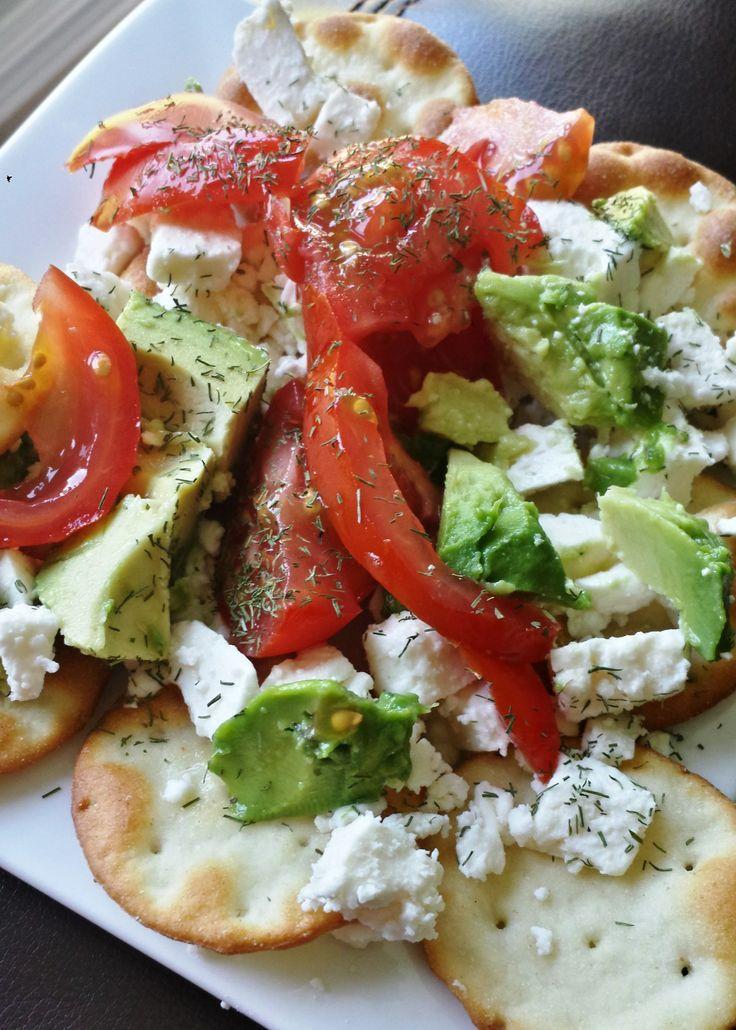 "Avocado ""nachos"" on pita crackers with feta, tomato, lemon juice, & dill. Healthy, meatless option."