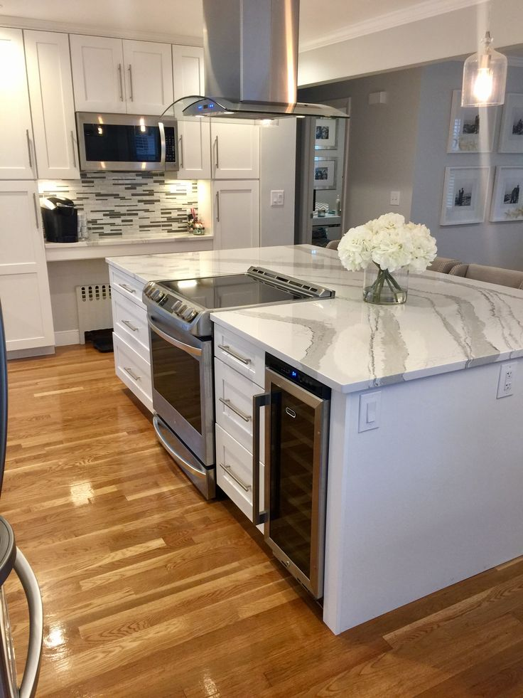 Huge Quartz Island Stove And Wine Fridge Open Floor Plan White Gray Cambria Bri