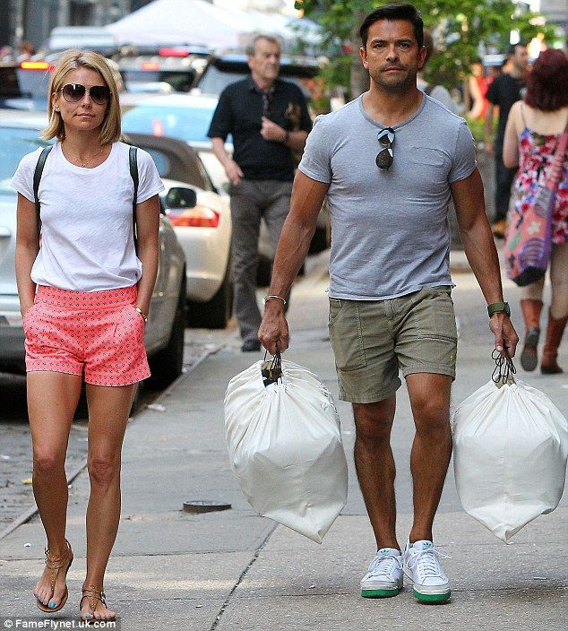 Bags of enthusiasm: Kelly Ripa and husband Mark Consuelos seemed to be enjoying their day ...
