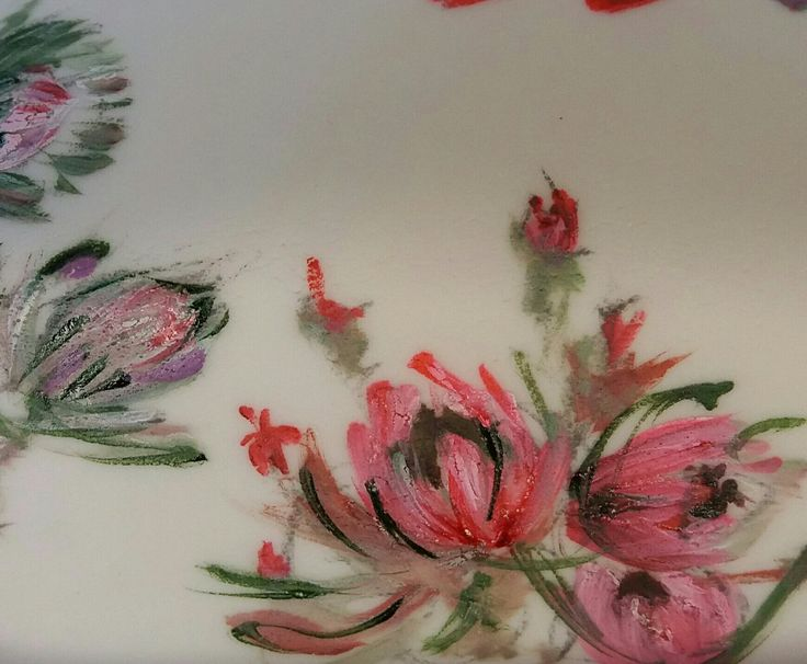 Dainty proteas painted on cake