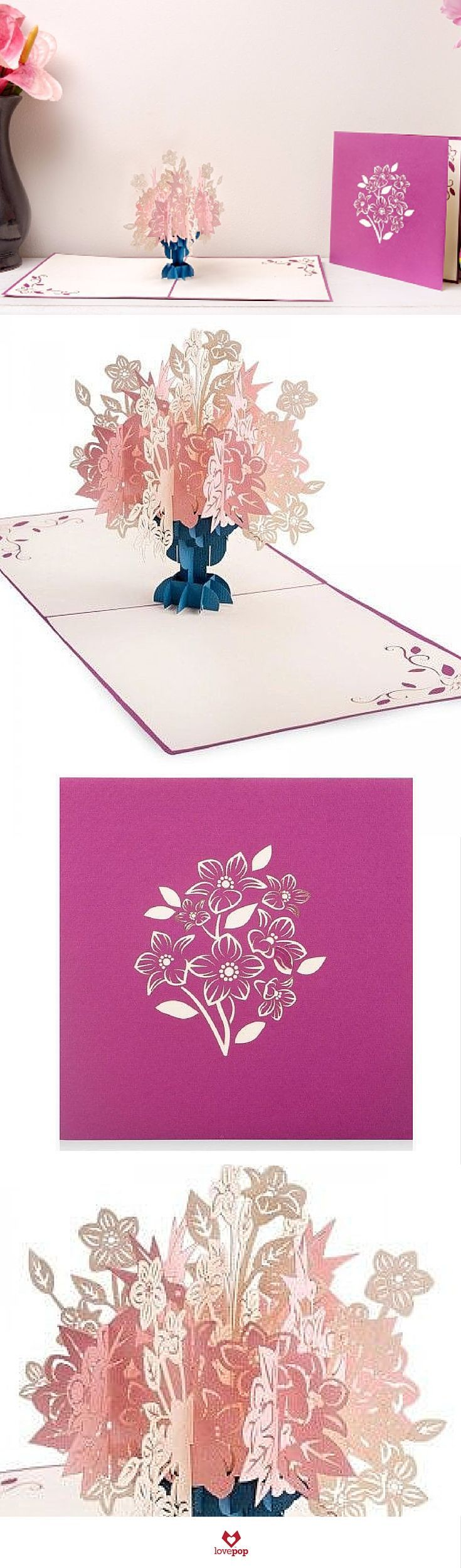 A bundle of purple flowers adorns the purple cover of this floral greeting card. Open the card to a lush surprise of white and pink flowers in a beautiful arrangement. Floral entanglements embellish t