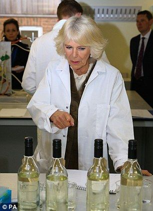 The Duchess of Cornwall dons a lab coat during a visit to the new Wine Research Centre at Plumpton College