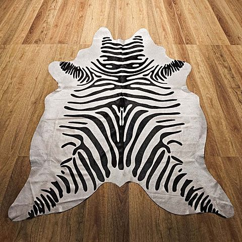 With authentic African animal characteristics and a high quality print technique, the Zebra Printed Animal Hide Rug from NSW Leather Co will embolden your space with character and charm.
