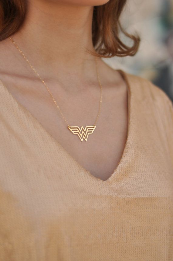 Gold Wonder Woman Necklace , Diana Prince Charm , Wonder Woman Jewelry , Super Hero Jewelry  Fun, sophisticated and declarative  Classic Double W for Wonder Woman necklace. The pendant is made ​​of brass plated with high quality nickel free gold and matte finish, on gold filled chain. Gold filled is a wonderful alternative for those who love gold but want something more affordable. This adorable necklace would make the greatest gift for you or for the Wonderwoman in your life.  Pendant…