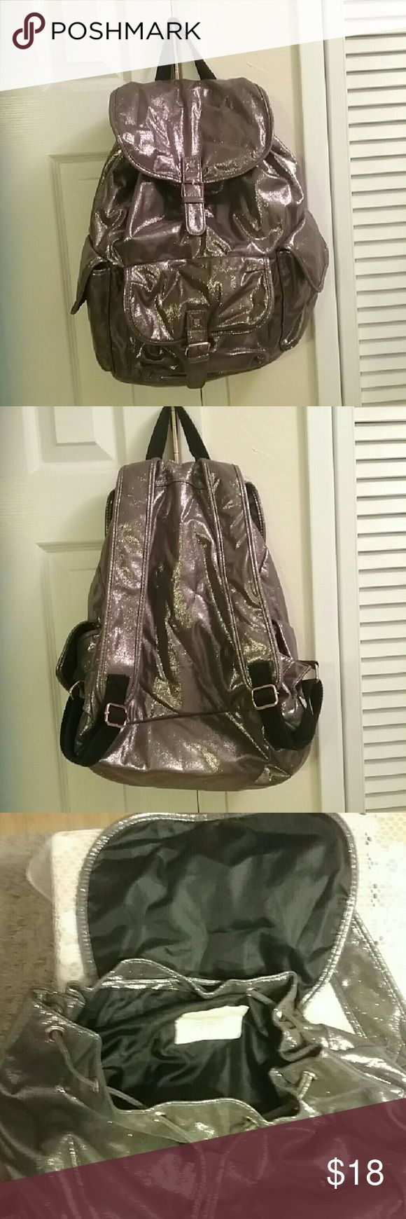 Shiny Silver Backpack- Live,Love,Dreams Collection Aeropostle Live,Love,Dreams Collection cute & stylish backpack- NEW condition used once. Many pockets, quality designer style..  BUNDLE & SAVE Aeropostale Bags Backpacks