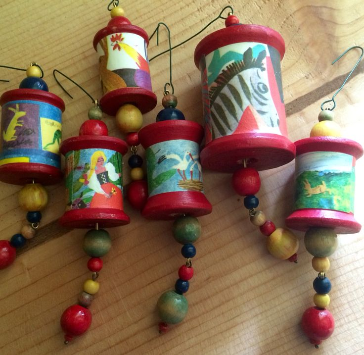 Wooden spool and vintage children's book pages - recycled ornaments by Melinda Barnett