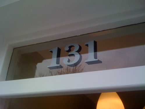 House numbers reverse painted onto glass door fanlight | Osborne Signs