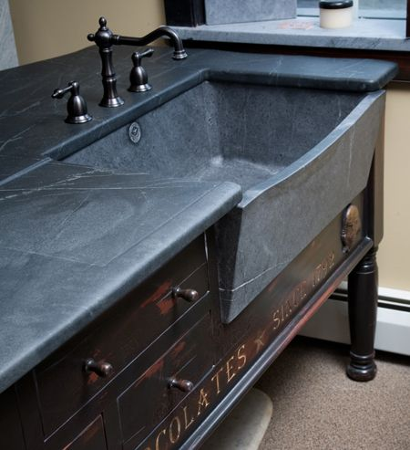 Franklin island sink with slant front and bow. So very elegant with that gentle curve to make it easier to work.