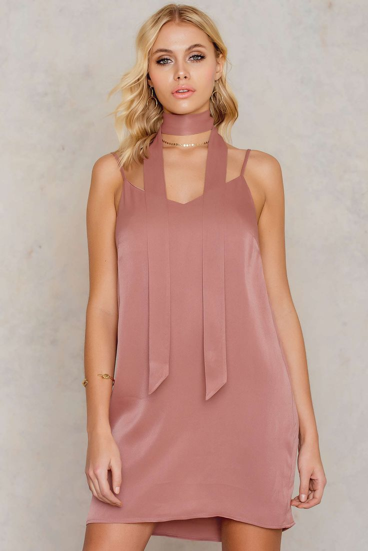 Keep it simple, keep it stylish! The Mini Slip Dress with Scarf by Tranloeve comes in dark blush and features a semi V-neckline, thin adjustable shoulder straps, regular fit and a matching scarf included for a complete look. Style this delicate slip dress with ankle boots, regular fit biker jacket and a cool cap!