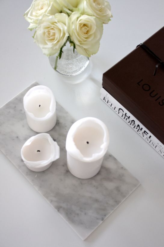 Marble with candles and coffee table books