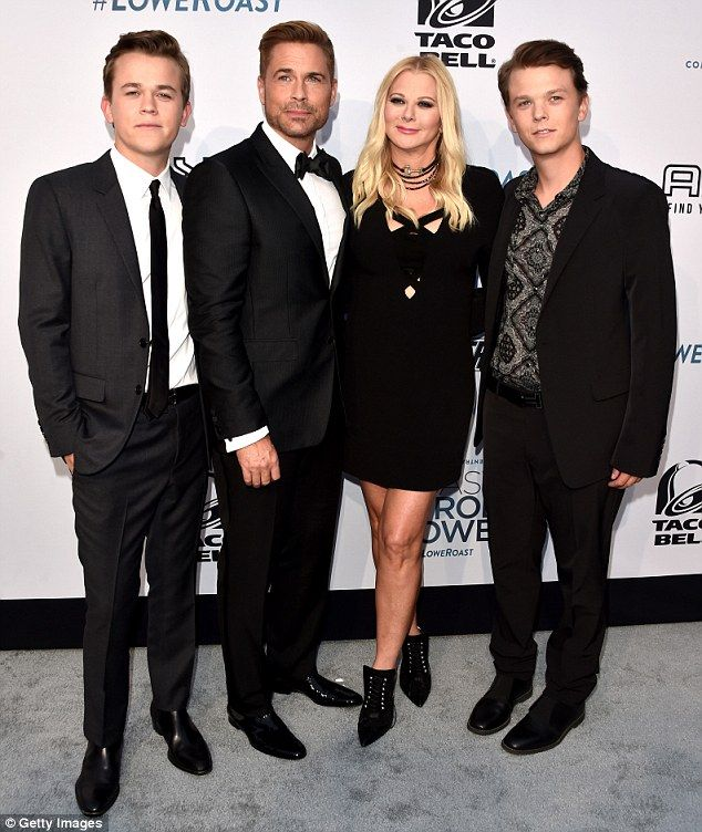 Great genes! Rob Lowe, 52, made his grand entrance at his Comedy Central Roast with his gorgeous family including (L-R) son John, 21, wife Sheryl Berkoff, 55, and son Matthew, 25