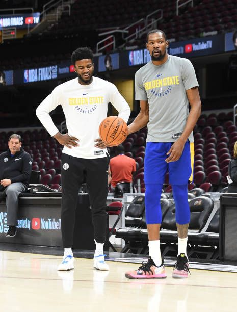 b8ffedf48c22 Kevin Durant chats with Jordan Bell of the Golden State Warriors during  practice and media availability as part of the 2018 NBA Finals on June 7  2018.