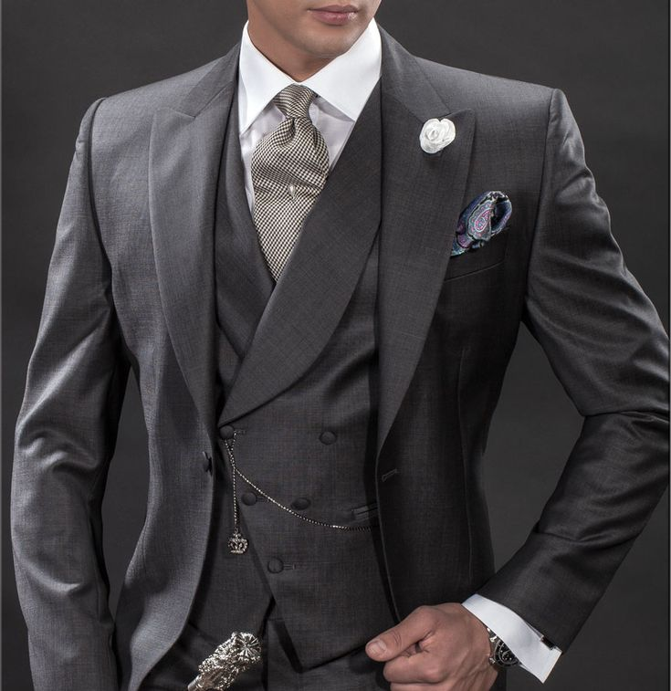 Monochrome gray Morning Suit in fil a fil fine-polyester (mixed) fabric. Black/White houndstooth pattern tie, cashmere handkerchief and white satin flower pin.