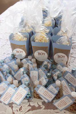 baby blue oh boy burlap baby shower favors.  Mini Handsanitizers with handmade tags.  Handmade popcorn boxes using the silhouette cameo.  my dirty apron