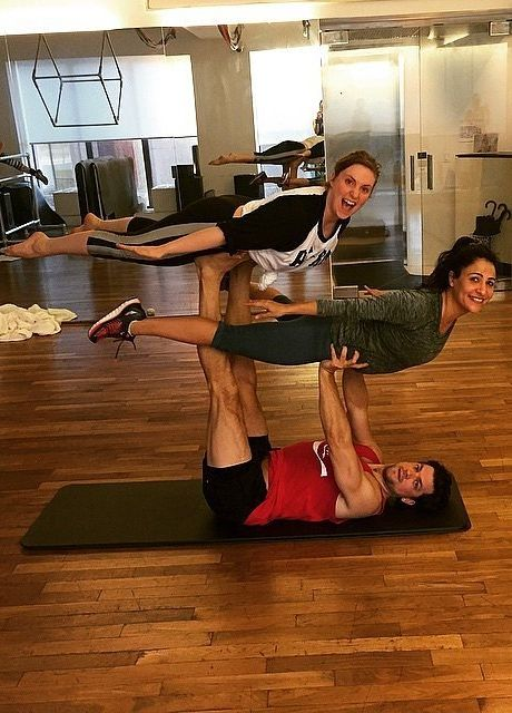 These photos of Lena Dunham doing Acroyoga make us want to try this partner yoga out immediately!