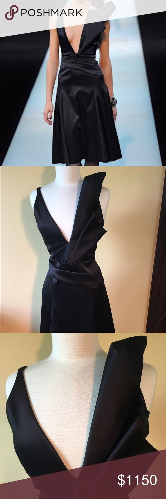 Giorgio Armani black label Silk Satin Dress This  gorgeous Giorgio Armani dress is from the  winter Runaway collection 2013-14. Plunging neck line on the actual dress is not as open as the runaway picture but it is very revealing. The dress is in a very good condition except a few snags in the front and back which needs to be looked at very closely.The dress is in a really good condition . Just little snags ( please refer to pictures) from the bracelet that I wore once. 😏 🌹🌹🌹🌹🌹🌹🌹…