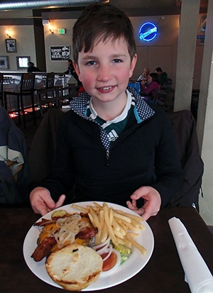 A boy and his bacon burger at Doc's Roadhouse at the Village at Winter Park Resort. #VisitGrandCounty