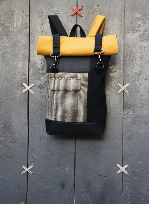 """Black,grey and ochre roll top rucksack with a pocket from men's suit as a front pocket, by """"Eating The Goober"""""""