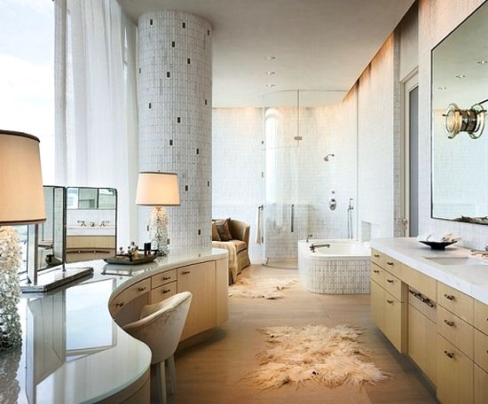 Luxurious bathroom with a vanity & modern tiles.