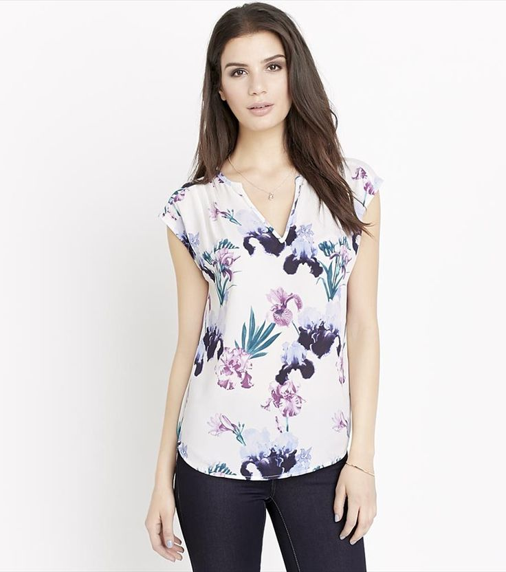 Take your look from boardroom to bar with this stunning floral pleated top.