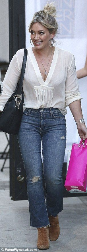 So chic: Hilary chose suede heeled boots with a large black bag for her daytime outing...
