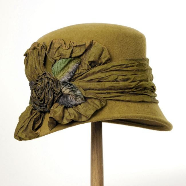 Oooh, more Louise Green Millinery. I'm pinning these because there's no chance I'll ever spend this much on a hat--pinning, however, is free.