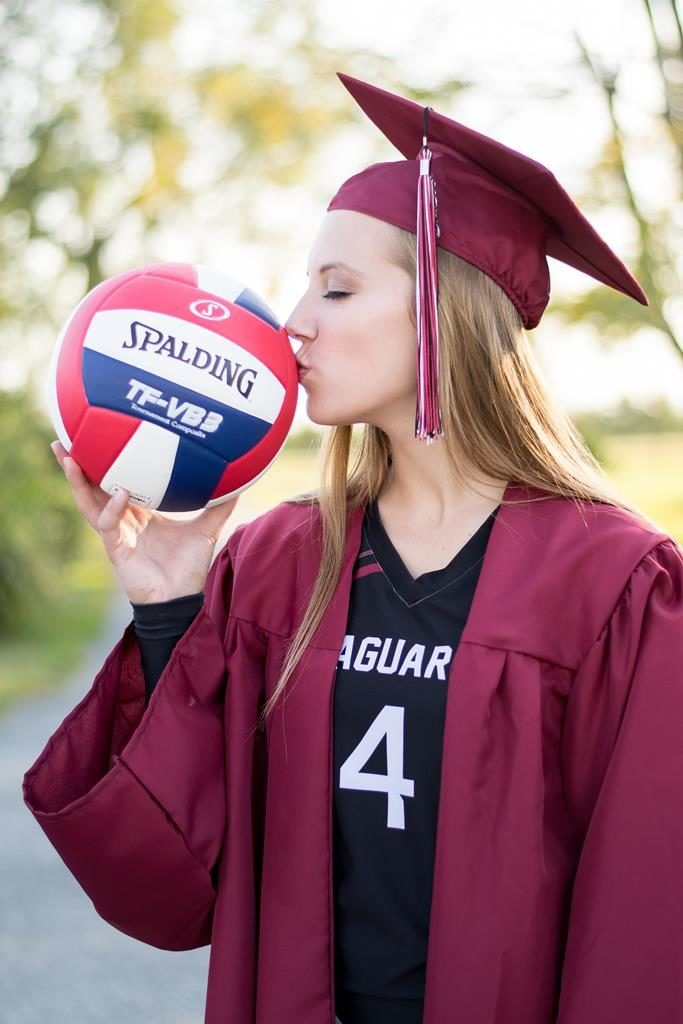 Volleyball senior pictures, Kiss the ball, Cap and gown, jersey underneath