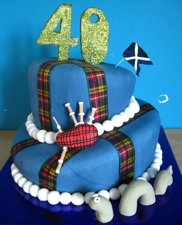 Scottish wonky cake with bag pipes, nessy and scottish flag