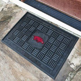"""Arkansas Razorbacks 19""""x30"""" Medallion Door Mat by CAS. $34.11. Welcome your guests in style with this officially licensed medallion door mat from Fanmats.. Measures 19""""x30"""" in size.. Each mat is boldly decorated with the team logo and features 100% vinyl construction with non-skid backing ensuring a rugged and safe product."""