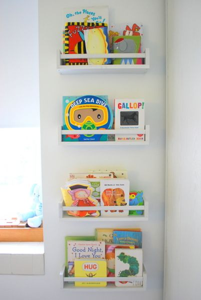 IKEA spice racks as bookshelves in nursery - great idea for a smaller space. Could use in the laundry.