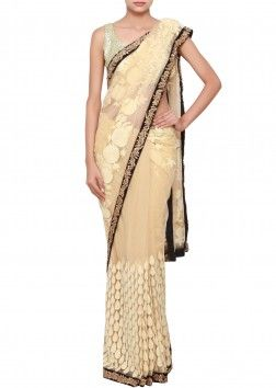 Beige saree in net embellished with thread work and zardosi embroidery only on Kalki