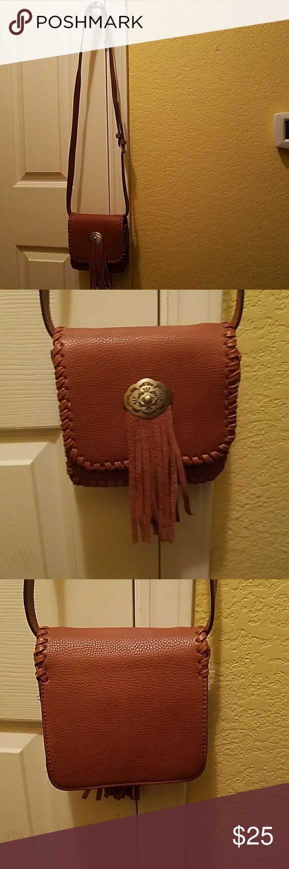 American Eagle Outfitters Mini Purse Bag is in great condition besides some minor scratches as shown in last two pictures. Bag has no pockets or zippers. Strap is adjustable. It was used one time. American Eagle Outfitters Bags Mini Bags