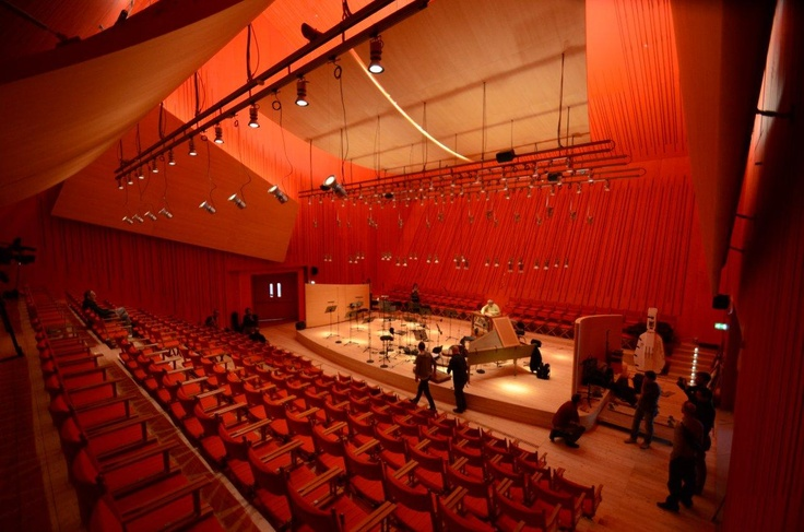 """Renzo Piano , Auditorium del Parco, L'Aquila (Italy)   Inside of the second """"cube"""" of the Audtiorium, with walls of wood painted in red and a very special acoustics...a work made in 2012 by www.loghouse.it"""