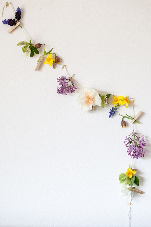floral garland on the wall. Flower photography. Beautiful floral, plant and nature photography and images. Re-pin for someone you know!