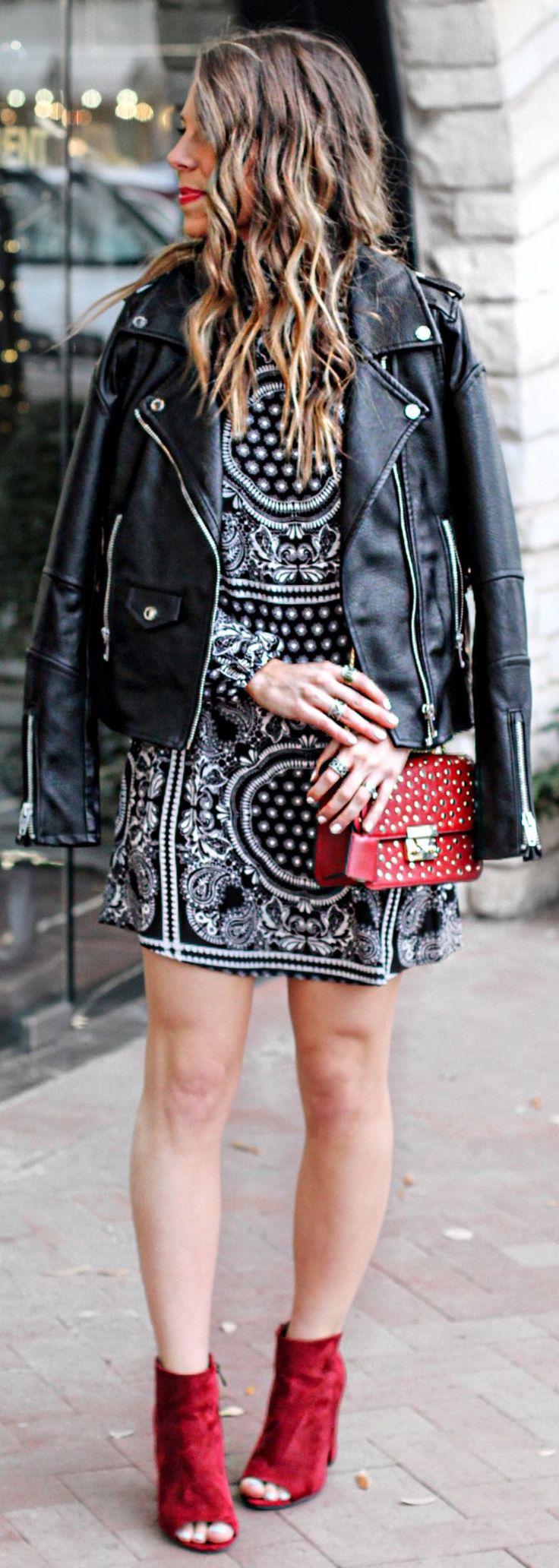 Black Leather Jacket / Printed Dress / Red Studded Shoulder Bag / Red Velvet Open Toe Booties