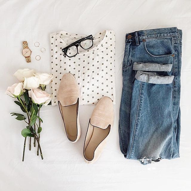 Worn in jeans, a polka dot top, and nude flats