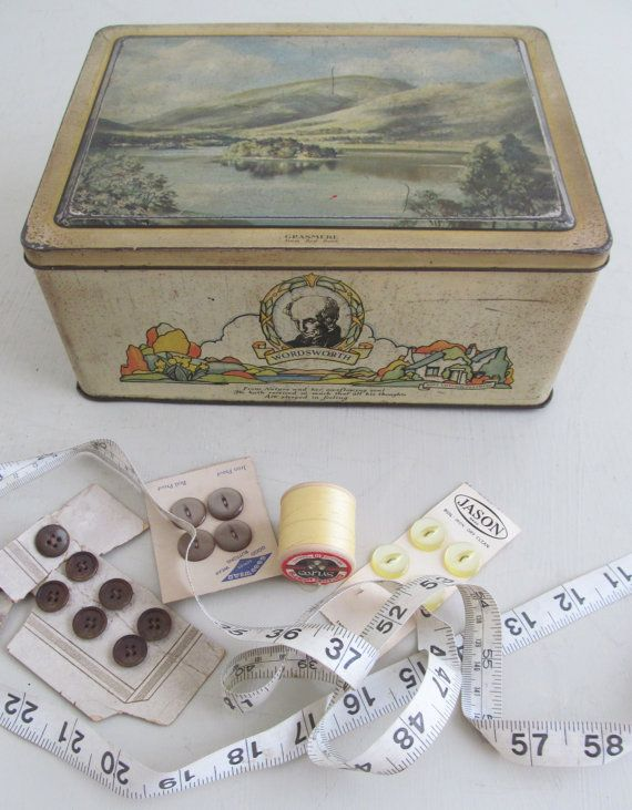 This charming vintage biscuit tin dates to the 1930s and the lithographed decoration is very reminiscent of Clarice Cliff with stylised