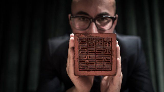 Sotheby's Asia's Nicolas Chow displays the Seal of the Mandate of Heaven