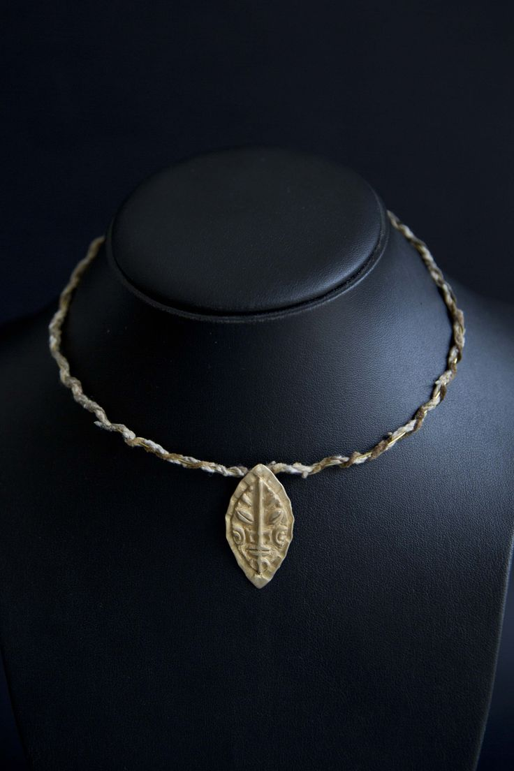 Lost wax casting in brass, tribal design. Thread & brass wire collar.
