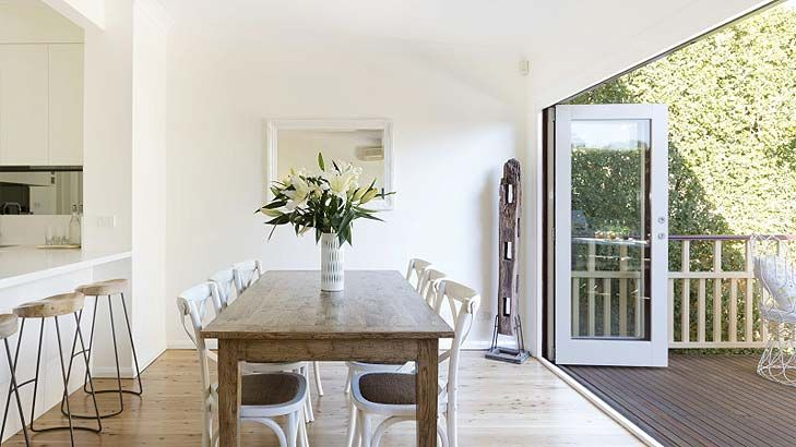 Perfect for entertaining is this Gladesville home's dining area with open onto a level deck - letting the sunshine in! #diningroom #deck #builder