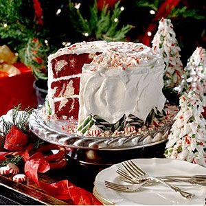 Red Velvet Peppermint Cake | Swirled velvety red-and-white cake layers are topped with a sweet Peppermint Cream Cheese Frosting in this showstopping layer cake.