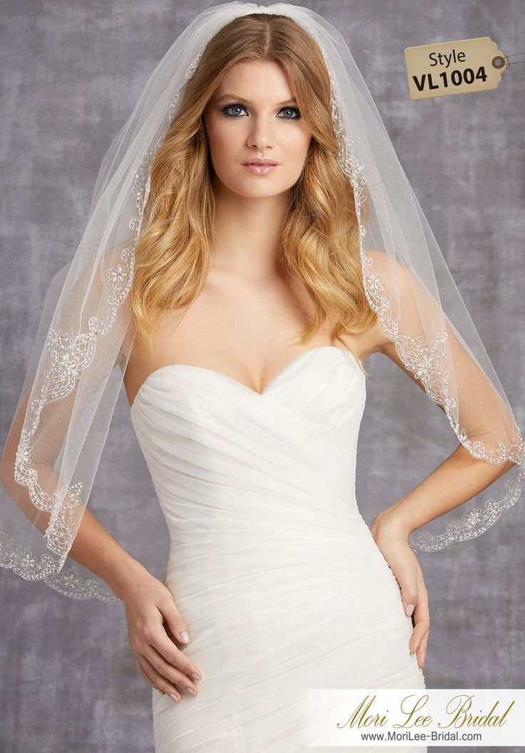 Style VL1004Veil Embroidered with Beads, Pearls and SequinsAvailable in Fingertip Length (VL1004F) Shown, or Cathedral Length (VL1004C). Colors: White, Ivory, Gold.
