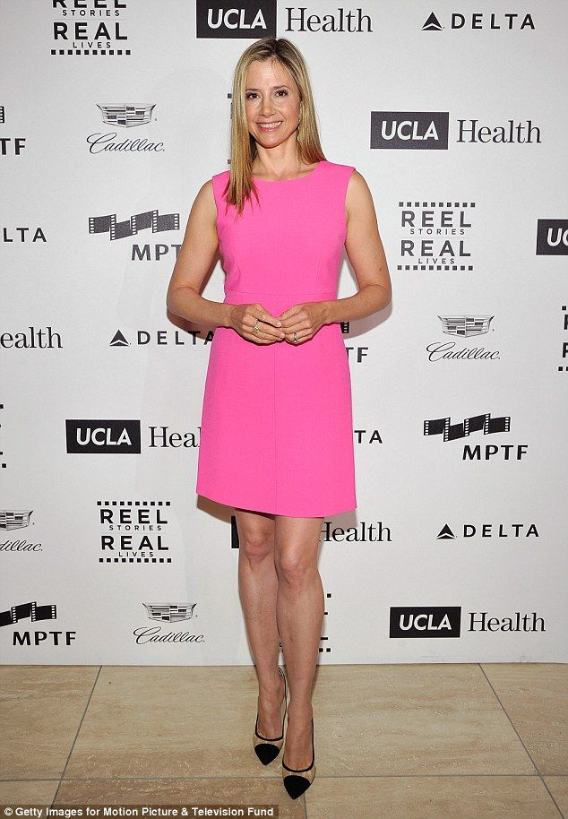 Bright spark: Mira Sorvino shone in a hot pink dress when she attended the fourth annual R...