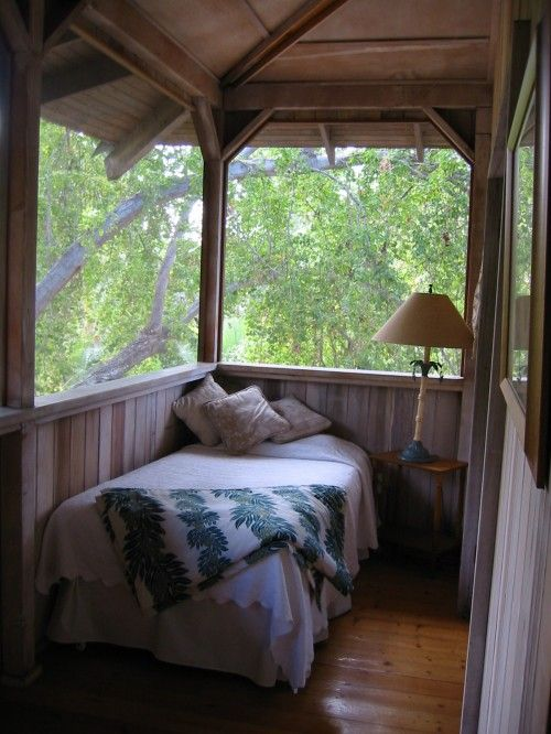 A traditional sleeping porch!  For those  nice nights when you just want to feel the breeze, hear the crickets, and see the stars....(sigh) I want this!!