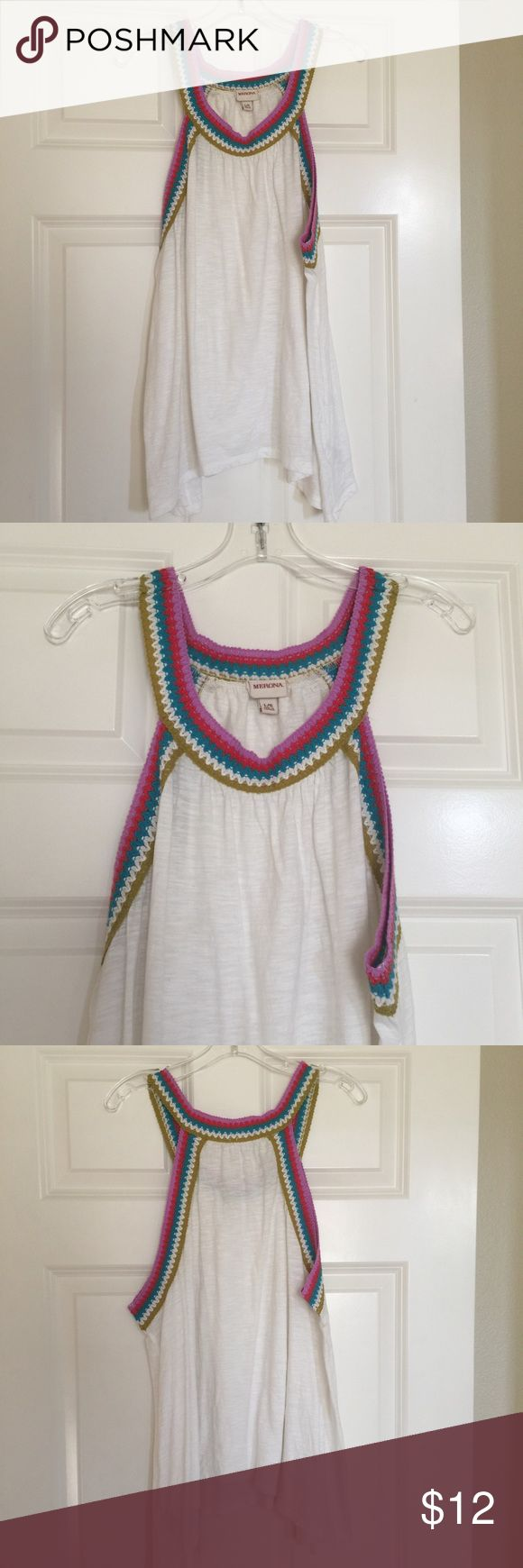 Razor back flowy tank top! This is a razor back flowy tank. The edges of the neck line are knit fabric in fun colors. It is longer on the sides make it a flattering fit Merona Tops Tank Tops
