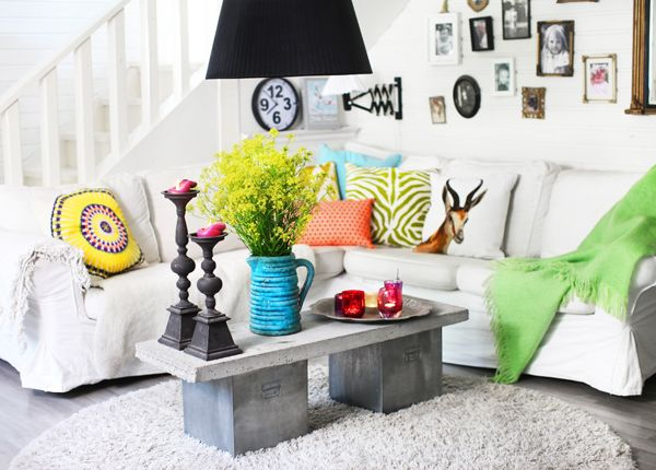Bold And Bright Living Room, Featuring Eclectic Pillows And A White Corner  Ektorp Sofa.