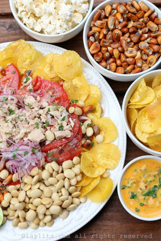 Tuna ceviche with sides of plantain chips, tostado or chulpi corn nuts ...