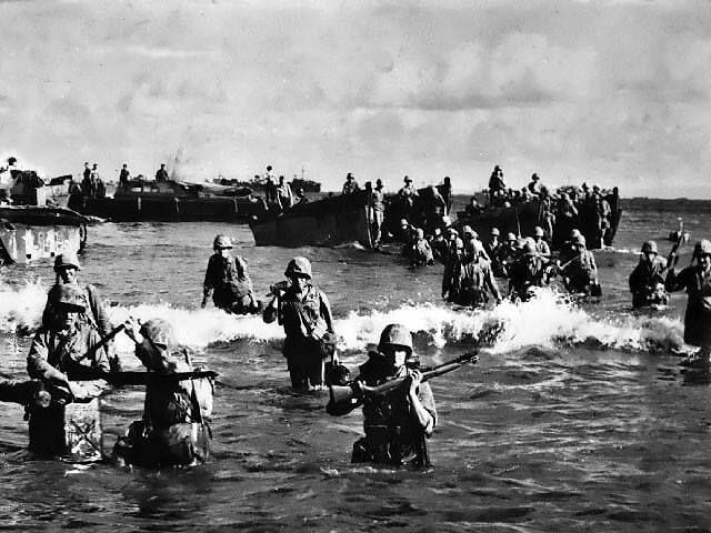 US Marines wading toward Tinian from amphibious tractors and landing boats Mariana Islands 25 July 1944.