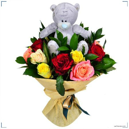 A bouquet of multicolored roses and a teddy bear