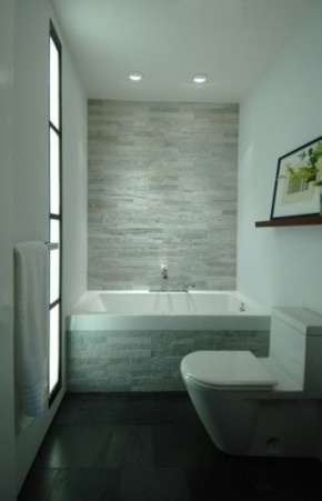 Simple, beautiful Small bathroom with a large tub and stately stone